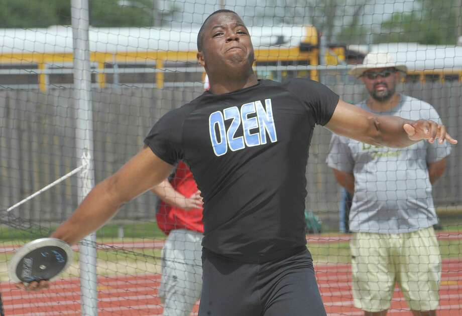 Anthony Sylvester, from Ozen High School, comes out of his twist ready to release the disc on one of his attempts. Babe Zaharias Stadium in Beaumont was the site for the District 20-4A track and field meet Monday April 8, 2013.   Dave Ryan/The Enterprise