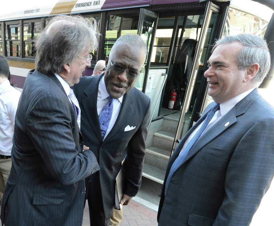 University at Albany president Robert Jones, center, is greeted by Schenectady Mayor Gary McCarthy, right, and David Buicko of the Galesi Group on Monday April 8, 2013, while he tours locations in Schenectday, N.Y. (Skip Dickstein/Times Union) Photo: SKIP DICKSTEIN / 10021894A