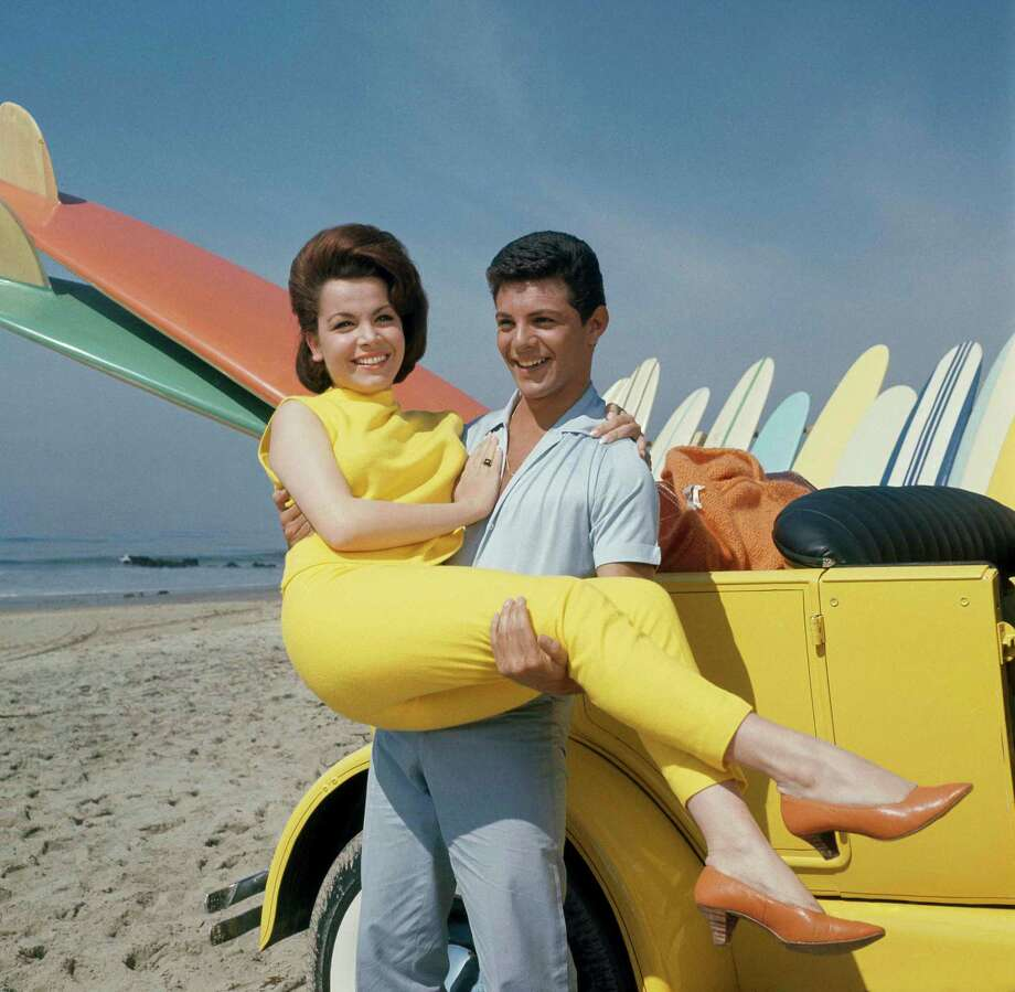 "Annette Funicello made six beach movies with Frankie Avalon, including ""Beach Party"" in 1963.  She once described the pairing as being the ""Ma and Pa Kettle of the surf set."" Photo: Uncredited, STF / AP"