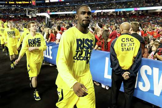 ATLANTA, GA - APRIL 08:  Tim Hardaway Jr. #10 of the Michigan Wolverines walks with his teammates towards the locker room after warm ups against the Louisville Cardinals during the 2013 NCAA Men's Final Four Championship at the Georgia Dome on April 8, 2013 in Atlanta, Georgia. Photo: Streeter Lecka, Getty Images / 2013 Getty Images