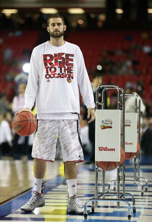 ATLANTA, GA - APRIL 08:  Luke Hancock #11 of the Louisville Cardinals looks on during warm ups against the Michigan Wolverines during the 2013 NCAA Men's Final Four Championship at the Georgia Dome on April 8, 2013 in Atlanta, Georgia. Photo: Streeter Lecka, Getty Images / 2013 Getty Images