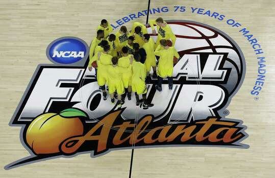 Michigan players huddle before the first half of the NCAA Final Four tournament college basketball championship game against the Louisville, Monday, April 8, 2013, in Atlanta. (AP Photo/David J. Phillip) Photo: David J. Phillip, Associated Press / AP