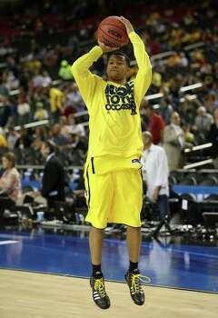 ATLANTA, GA - APRIL 08:  Trey Burke #3 of the Michigan Wolverines warms up against the Louisville Cardinals during the 2013 NCAA Men's Final Four Championship at the Georgia Dome on April 8, 2013 in Atlanta, Georgia. Photo: Streeter Lecka, Getty Images / 2013 Getty Images