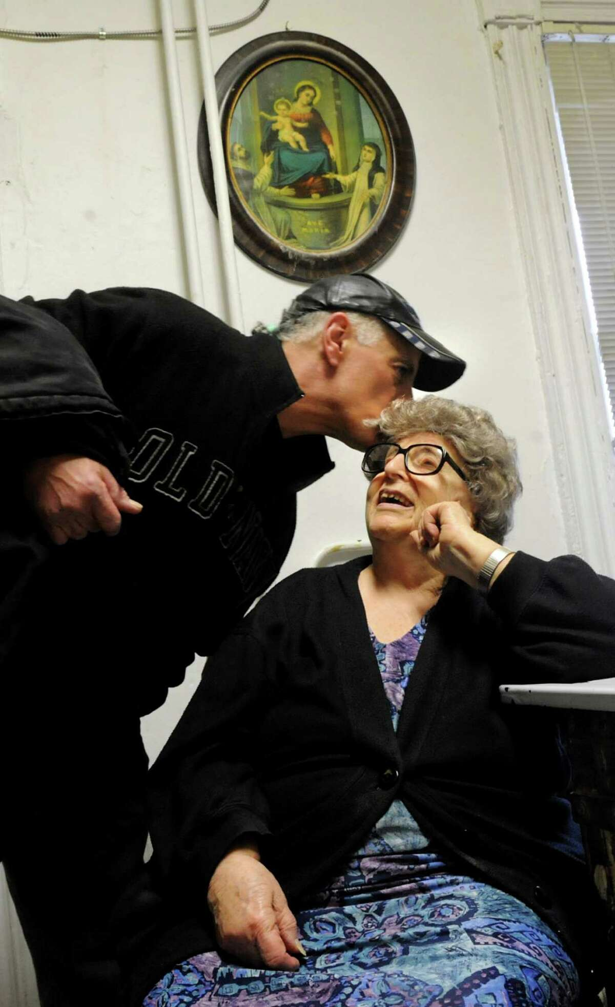 Employee Eddie DeLorenzo, left, gives Lilia Perreca Papa a good-bye kiss as he leaves work on Wednesday, March 13, 2013, at Perreca's Bakery in Schenectady, N.Y. (Cindy Schultz / Times Union)