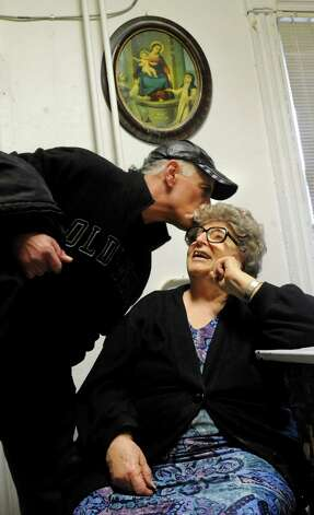 Employee Eddie DeLorenzo, left, gives Lilia Perreca Papa a good-bye kiss as he leaves work on Wednesday, March 13, 2013, at Perreca's Bakery in Schenectady, N.Y. (Cindy Schultz / Times Union) Photo: Cindy Schultz / 00021744A
