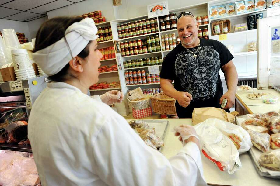 Owner Maria Perreca Papa, left, jokes with customer and family friend Vincent Vardine Jr. of Schenectady on Saturday, March 30, 2013, at Perreca's Bakery in Schenectady, N.Y. (Cindy Schultz / Times Union) Photo: Cindy Schultz / 00021744A