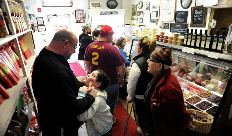 Customers fill the small shop on Saturday, March 30, 2013, at Perreca's Bakery in Schenectady, N.Y. (Cindy Schultz / Times Union) Photo: Cindy Schultz / 00021744A