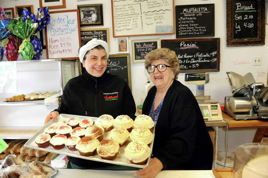 Owner Maria Perreca Papa, left, and her mother, Lilia Perreca Papa, pose with cupcakes on Wednesday, March 13, 2013, at Perreca's Bakery in Schenectady, N.Y. Lilia's parents, Salvatore and Carmella Perreca founded the business in 1914. (Cindy Schultz / Times Union) Photo: Cindy Schultz / 00021744A