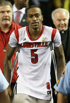 ATLANTA, GA - APRIL 08:  Injured guard Kevin Ware #5 of the Louisville Cardinals walks out to the court against the Michigan Wolverines during the 2013 NCAA Men's Final Four Championship at the Georgia Dome on April 8, 2013 in Atlanta, Georgia. Photo: Streeter Lecka, Getty Images / 2013 Getty Images