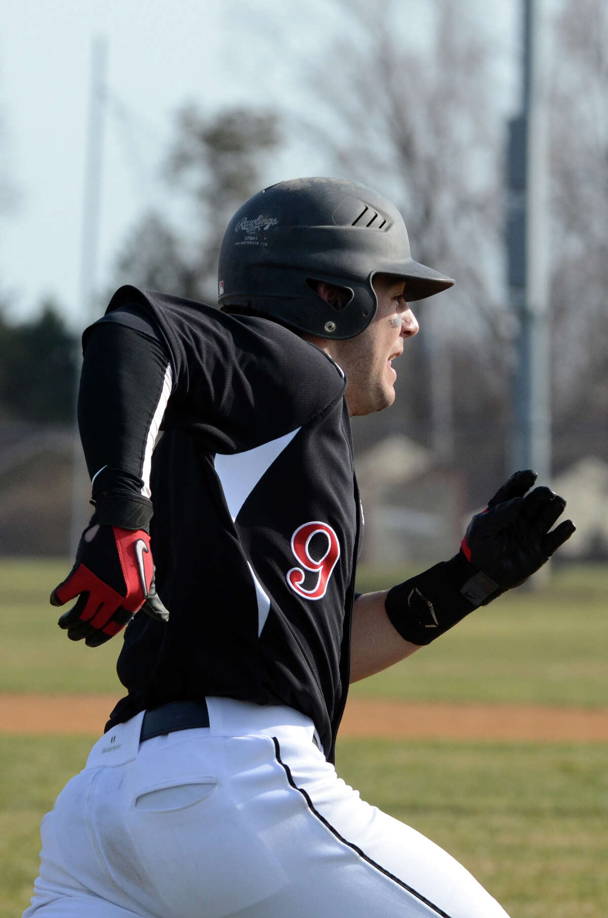 New Canaan's Nick Cascione (9) makes a run for first base on a hit during the baseball game against Trumbull at Trumbull High School on Monday, Apr. 8, 2013.