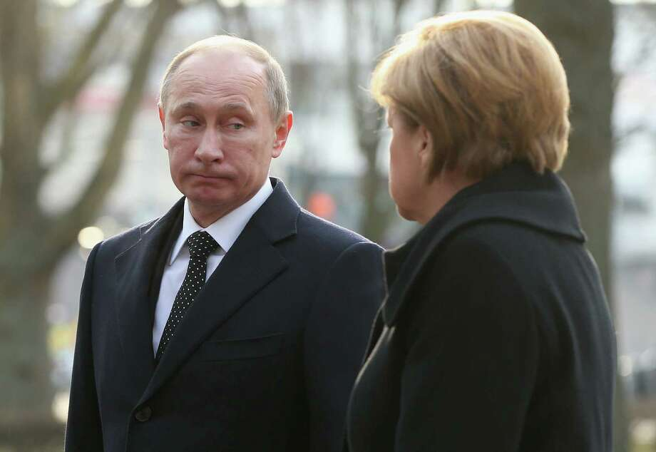 """German Chancellor Angela Merkel, shown with Russian President Vladimir Putin, said nongovernmental groups need to be allowed to work """"without fear or concern."""" Photo: Sean Gallup / Getty Images"""