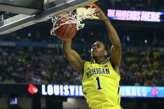 ATLANTA, GA - APRIL 08:  Glenn Robinson III #1 of the Michigan Wolverines dunks in the first half against the Louisville Cardinals during the 2013 NCAA Men's Final Four Championship at the Georgia Dome on April 8, 2013 in Atlanta, Georgia. Photo: Streeter Lecka, Getty Images / 2013 Getty Images