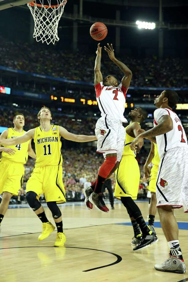 ATLANTA, GA - APRIL 08:  Russ Smith #2 of the Louisville Cardinals drives for a shot attempt in the first half against Nik Stauskas #11 of the Michigan Wolverines during the 2013 NCAA Men's Final Four Championship at the Georgia Dome on April 8, 2013 in Atlanta, Georgia. Photo: Andy Lyons, Getty Images / 2013 Getty Images