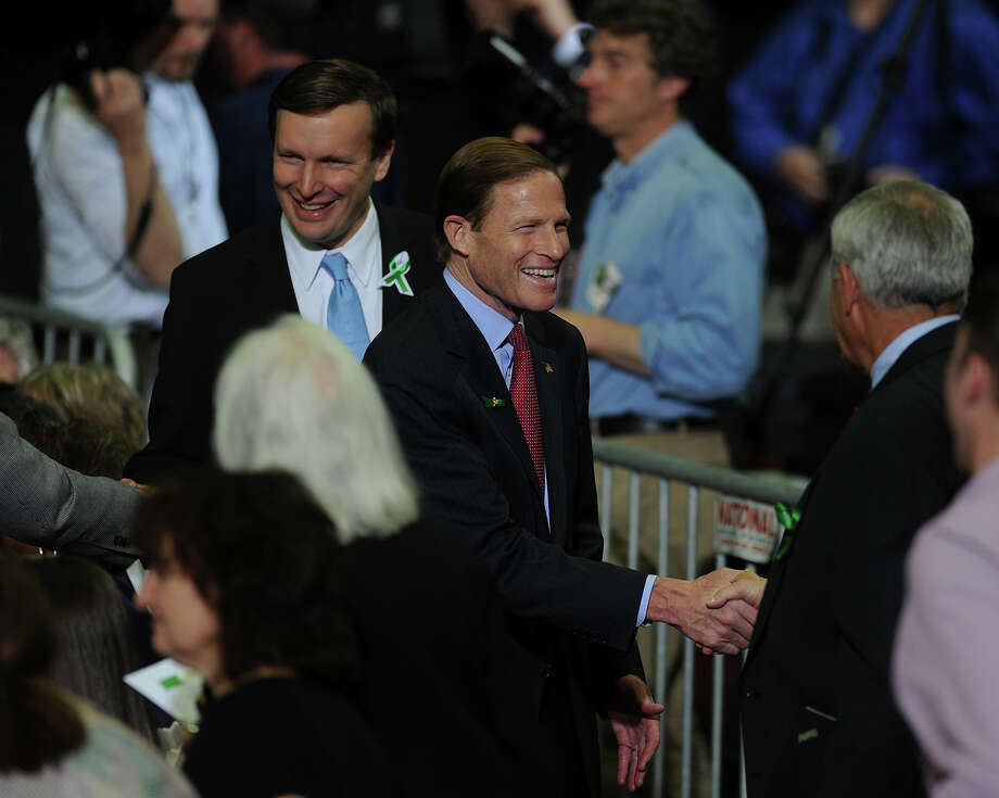 Rep. Chris Murphy, left, and Sen. Richard Blumenthal attend President Barack Obama speech on gun control at the University of Hartford in West Hartford, Conn. on Monday, April 8, 2013. Photo: Brian A. Pounds / Connecticut Post