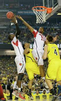 Gorgui Dieng (10) and Chane Behanan (21) of the Louisville Cardinals go for a rebound against the Michigan Wolverines in the NCAA Tournament finals at the Georgia Dome in Atlanta, Georgia, Monday, April 8, 2013. (Harry E. Walker/MCT) Photo: Harry E. Walker, McClatchy-Tribune News Service / MCT