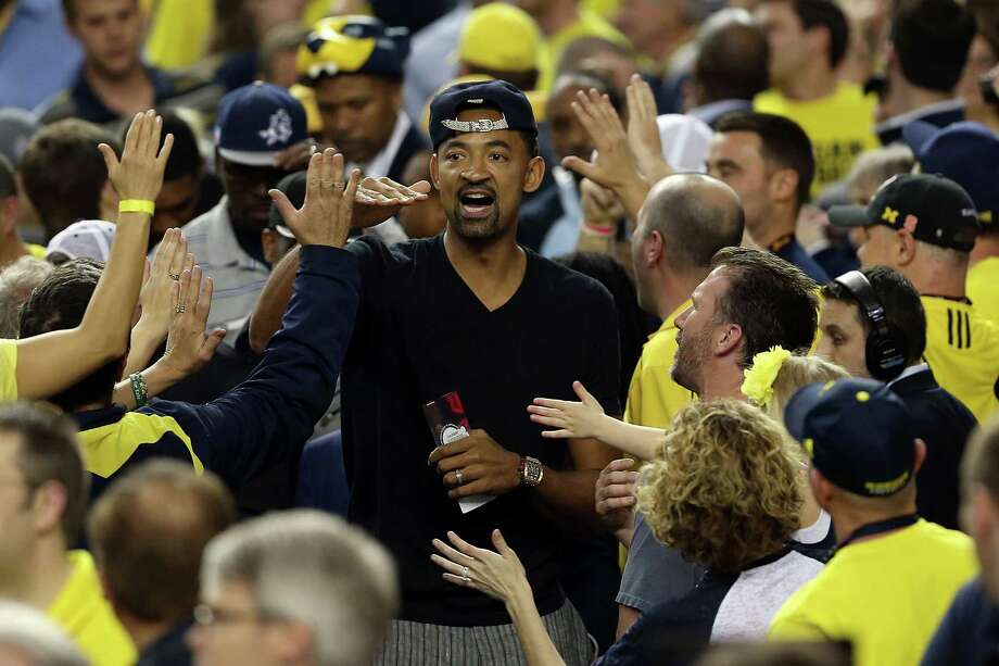 ATLANTA, GA - APRIL 08:  Former Michigan Wolverines player Juwan Howard greets Michigan fans in the stands against the Louisville Cardinals during the 2013 NCAA Men's Final Four Championship at the Georgia Dome on April 8, 2013 in Atlanta, Georgia. Photo: Andy Lyons, Getty Images / 2013 Getty Images