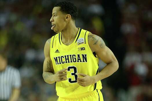 ATLANTA, GA - APRIL 08:  Trey Burke #3 of the Michigan Wolverines reacts in the first half against the Louisville Cardinals during the 2013 NCAA Men's Final Four Championship at the Georgia Dome on April 8, 2013 in Atlanta, Georgia. Photo: Andy Lyons, Getty Images / 2013 Getty Images