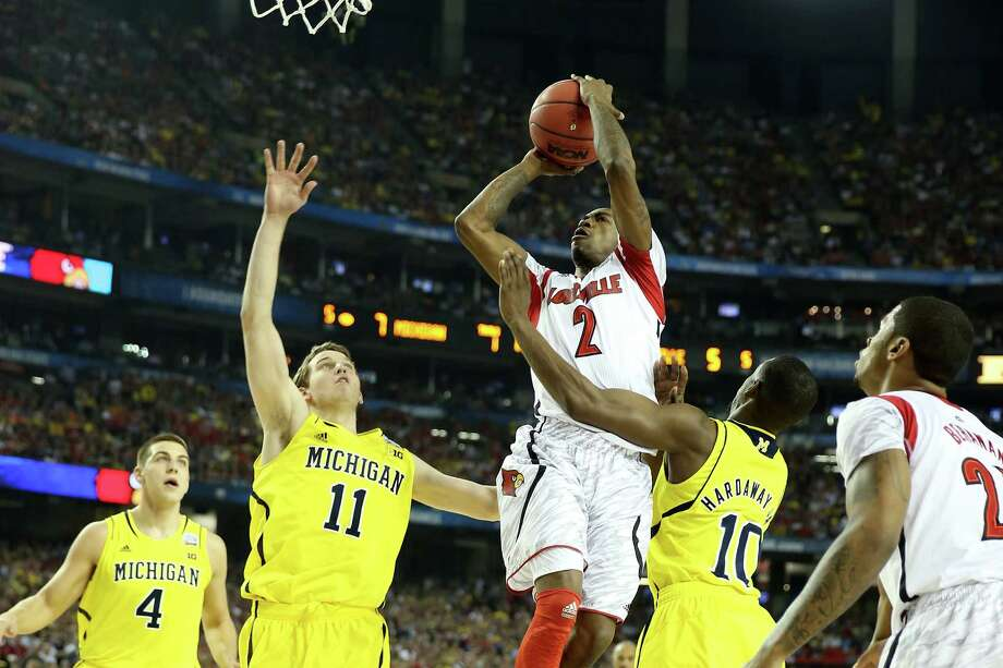 Louisville 82, Michigan 76Road to Atlanta: Look back at the full March Madness bracketLive updates: Follow all the Final Four actionATLANTA, GA - APRIL 08:  Russ Smith #2 of the Louisville Cardinals drives for a shot attempt in the first half against Nik Stauskas #11 and Tim Hardaway Jr. #10 of the Michigan Wolverines during the 2013 NCAA Men's Final Four Championship at the Georgia Dome on April 8, 2013 in Atlanta, Georgia. Photo: Andy Lyons, Getty Images / 2013 Getty Images