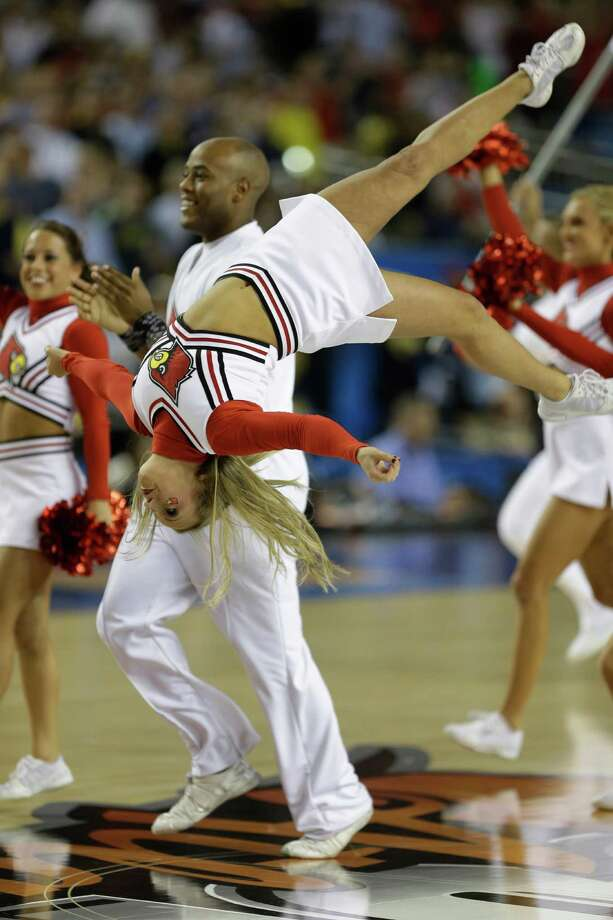 Louisville cheerleaders perform before the NCAA Final Four tournament college basketball championship game against the Michigan Monday, April 8, 2013, in Atlanta. (AP Photo/Charlie Neibergall) Photo: Charlie Neibergall, Associated Press / AP