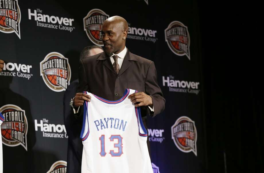 Former NBA player Gary Payton holds his jersey during the Naismith Memorial Basketball Hall of Fame class announcement on Monday in Atlanta.