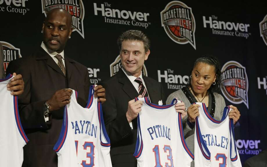 Former NBA Player Gary Payton, from left, Louisville coach Rick Pitino and three-time gold medalist Dawn Staley stand on stage during the Naismith Memorial Basketball Hall of Fame class announcement on Monday in Atlanta.