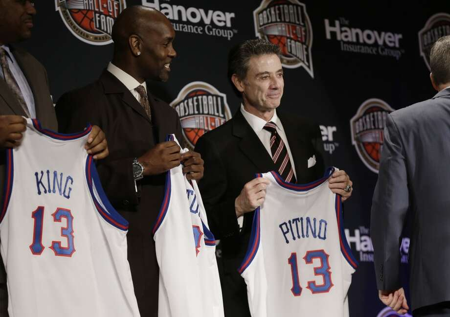 Former NBA Player Gary Payton, left, and Louisville coach Rick Pitino stand on stage during the Naismith Memorial Basketball Hall of Fame class announcement on Monday in Atlanta.