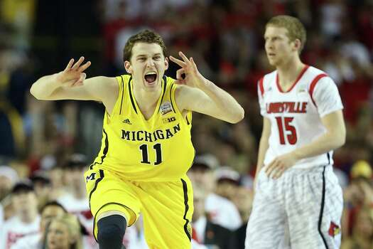 ATLANTA, GA - APRIL 08:  Nik Stauskas #11 of the Michigan Wolverines reacts in the first half against Tim Henderson #15 of the Louisville Cardinals during the 2013 NCAA Men's Final Four Championship at the Georgia Dome on April 8, 2013 in Atlanta, Georgia. Photo: Andy Lyons, Getty Images / 2013 Getty Images