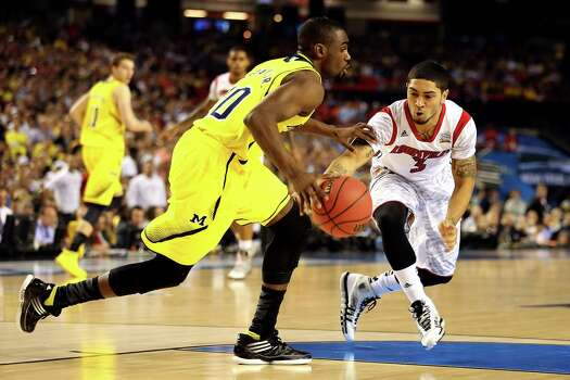 ATLANTA, GA - APRIL 08:  Peyton Siva #3 of the Louisville Cardinals attempts to steal the ball in the first half from Tim Hardaway Jr. #10 of the Michigan Wolverines during the 2013 NCAA Men's Final Four Championship at the Georgia Dome on April 8, 2013 in Atlanta, Georgia. Photo: Andy Lyons, Getty Images / 2013 Getty Images