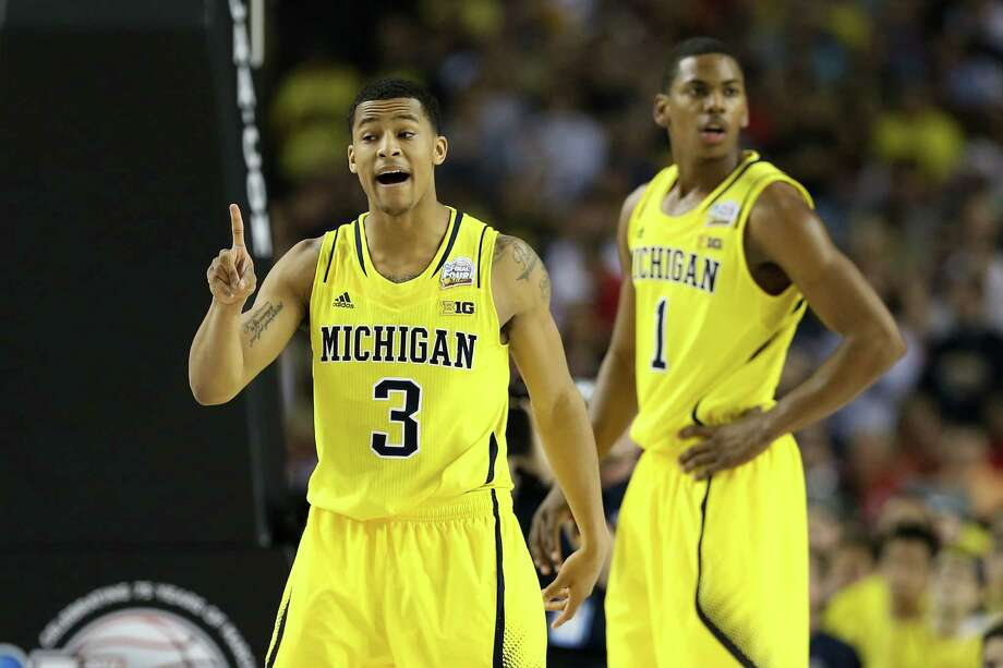 ATLANTA, GA - APRIL 08:  (L-R) Trey Burke #3 and Glenn Robinson III #1 of the Michigan Wolverines react in the first half against the Louisville Cardinals during the 2013 NCAA Men's Final Four Championship at the Georgia Dome on April 8, 2013 in Atlanta, Georgia. Photo: Streeter Lecka, Getty Images / 2013 Getty Images