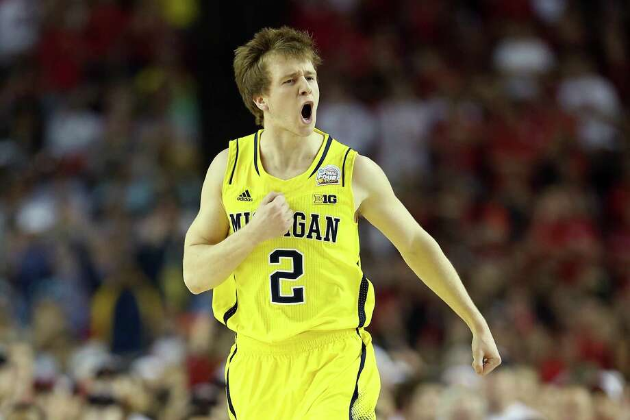 ATLANTA, GA - APRIL 08:  Spike Albrecht #2 of the Michigan Wolverines reacts in the first half against the Louisville Cardinals during the 2013 NCAA Men's Final Four Championship at the Georgia Dome on April 8, 2013 in Atlanta, Georgia. Photo: Andy Lyons, Getty Images / 2013 Getty Images