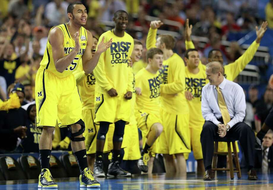 ATLANTA, GA - APRIL 08:  Jon Horford (L) #15 and head coach John Beilein of the Michigan Wolverines react along with players on the bench in the first half  against the Louisville Cardinals during the 2013 NCAA Men's Final Four Championship at the Georgia Dome on April 8, 2013 in Atlanta, Georgia. Photo: Streeter Lecka, Getty Images / 2013 Getty Images