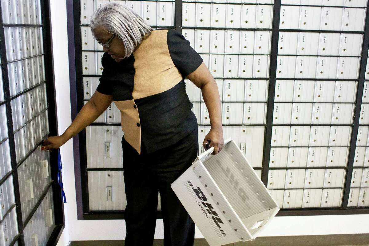 Prairie View clerk Linda Durham checks a post office box that the city is forced to rent on the Prairie View A&M campus because of the ZIP code confusion.