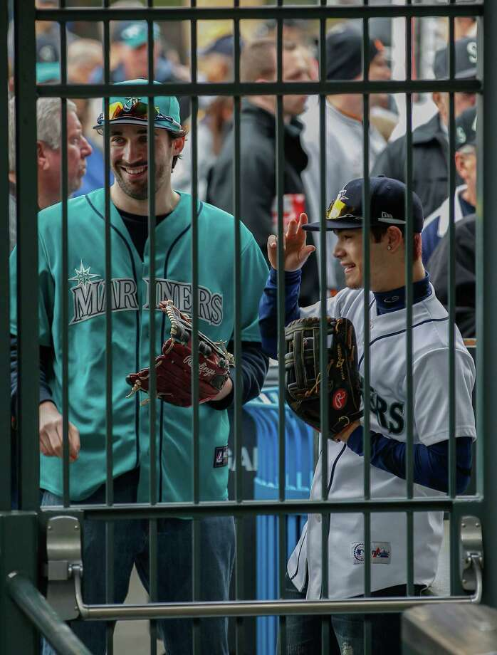 Fans wait for the turnstiles to open prior to the game between the Seattle Mariners and the Houston Astros. Photo: Otto Greule Jr, Getty Images / 2013 Getty Images