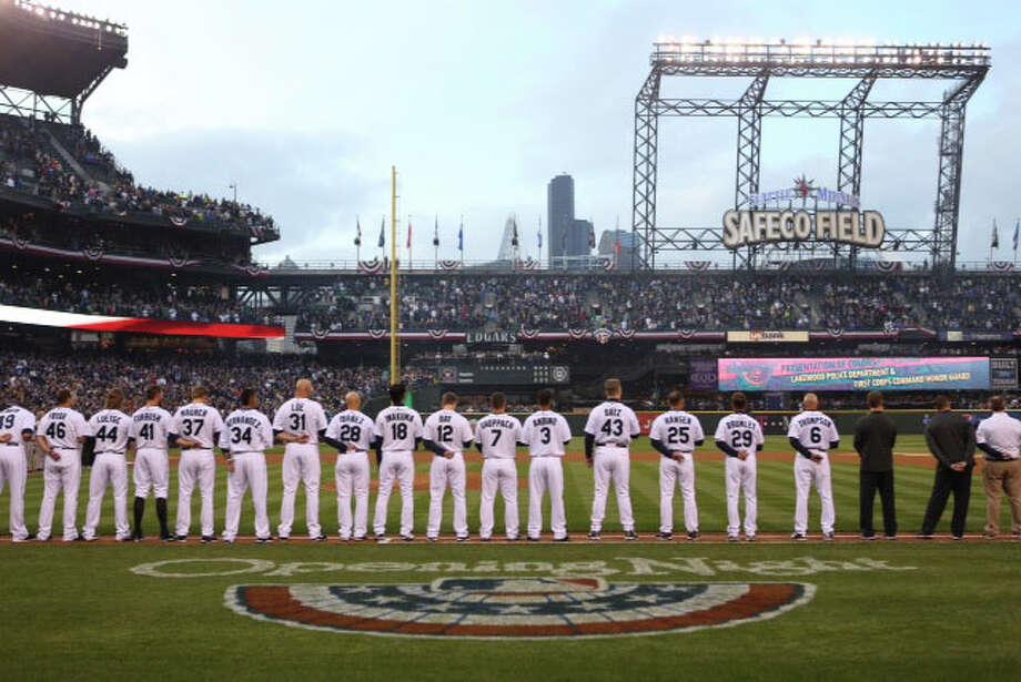 Players line up during pregame ceremonies. Photo: Joshua Trujillo / seattlepi.com