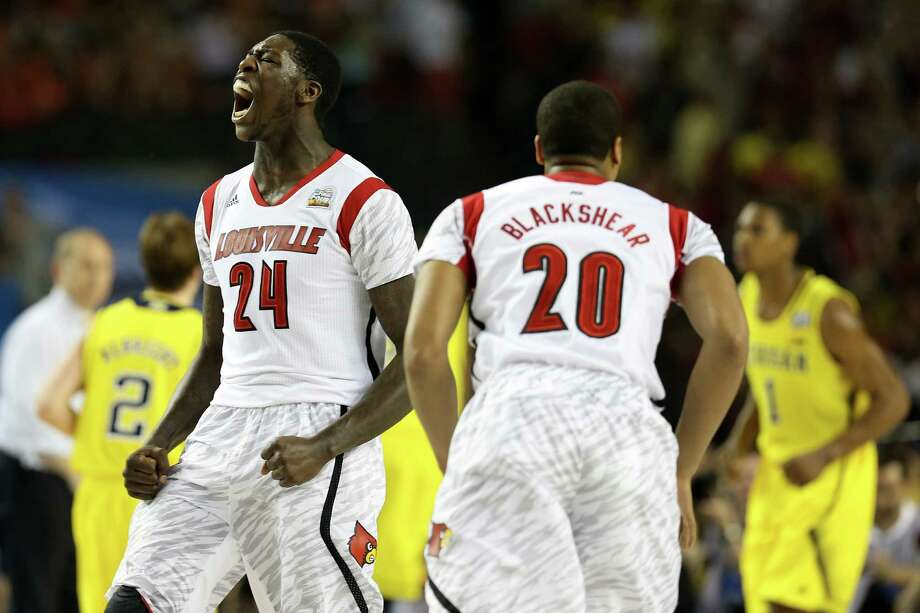 ATLANTA, GA - APRIL 08:  (L-R) Montrezl Harrell #24  and Wayne Blackshear #20 of the Louisville Cardinals react after Harrell dunked the ball in the first half against the Michigan Wolverines during the 2013 NCAA Men's Final Four Championship at the Georgia Dome on April 8, 2013 in Atlanta, Georgia. Photo: Streeter Lecka, Getty Images / 2013 Getty Images