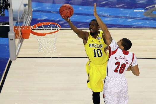 ATLANTA, GA - APRIL 08:  Tim Hardaway Jr. #10 of the Michigan Wolverines drives for a shot attempt in the first half against Wayne Blackshear #20 of the Louisville Cardinals during the 2013 NCAA Men's Final Four Championship at the Georgia Dome on April 8, 2013 in Atlanta, Georgia. Photo: Kevin C. Cox, Getty Images / 2013 Getty Images