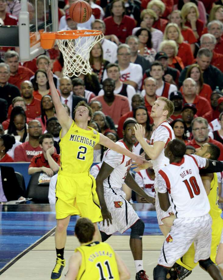 Spike Albrecht (2) of the Michigan Wolverines drives and puts up a shot against the Louisville Cardinals in the first half of the NCAA Tournament final at the Georgia Dome in Atlanta, Georgia, Monday, April 8, 2013. (Drew Tarter/MCT) Photo: Drew Tarter, McClatchy-Tribune News Service / MCT