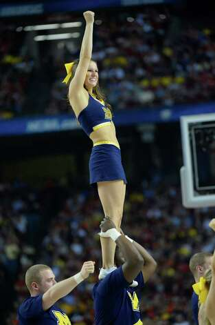 The Michigan cheerleaders perform during a timeout in the NCAA Tournament final between Michigan and Louisville at the Georgia Dome in Atlanta, Georgia, Monday, April 8, 2013. (Harry E. Walker/MCT) Photo: Harry E. Walker, McClatchy-Tribune News Service / MCT