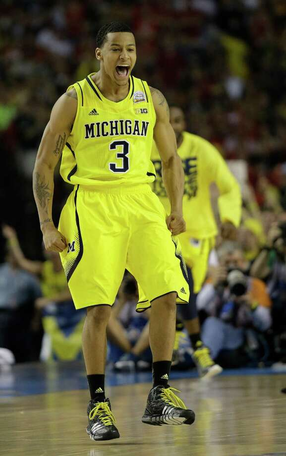 Michigan guard Trey Burke (3) reacts to play against the Louisville during the first half of the NCAA Final Four tournament college basketball championship game Monday, April 8, 2013, in Atlanta. (AP Photo/David J. Phillip) Photo: David J. Phillip, Associated Press / AP