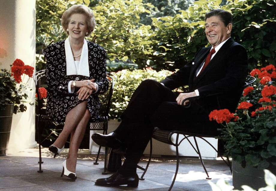 "Prime Minister Margaret Thatcher and President Ronald Reagan, shown in 1987, had ""the most enduring personal alliance in the Western world throughout the 1980s,"" author Hugo Young said. Photo: Mike Sargent / Getty Images"