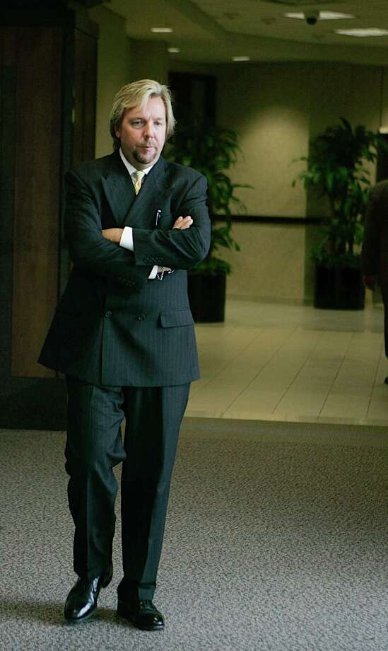 Plaintiffs attorney Brent Coon takes a break outside the Galveston, Texas courtroom Monday, Sept. 10, 2007 during first civil trial stemming from the March 2005 explosion that killed 15 people and injured more than 170 others at BP's Texas City refinery. (AP Photo/Pat Sullivan) Photo: Pat Sullivan, STF / AP