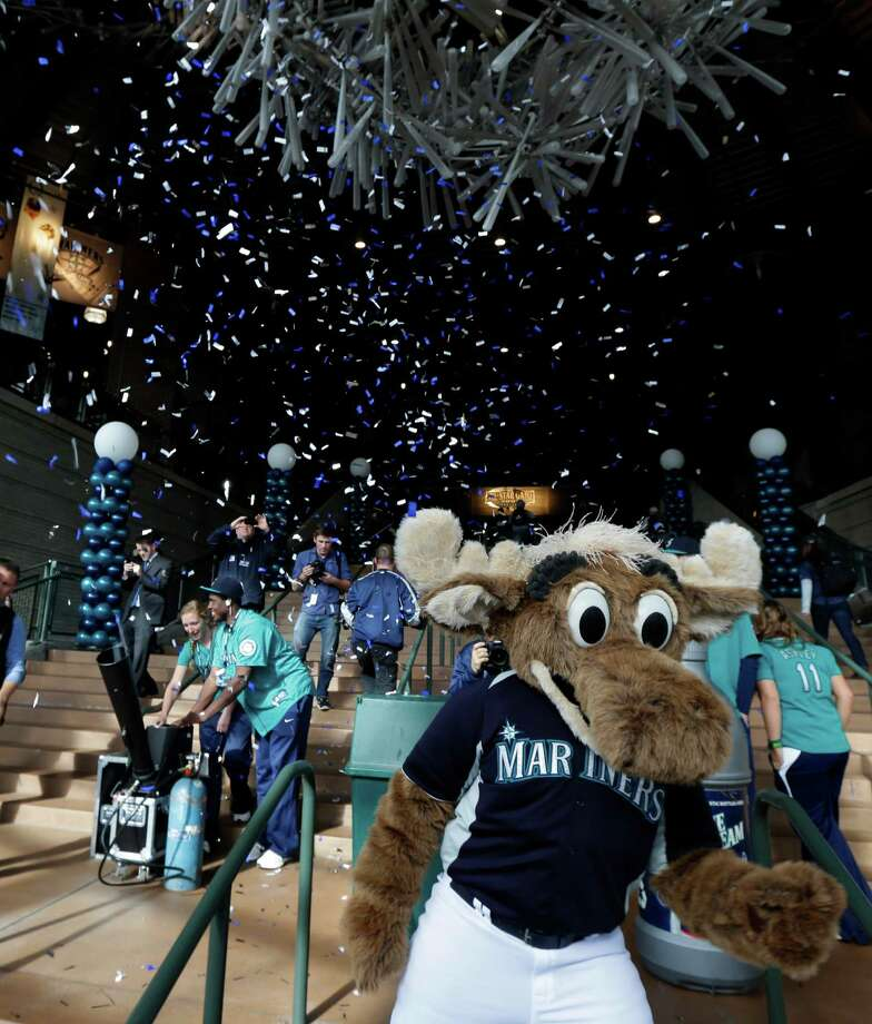 "Confetti flies as ""Moose,"" the Seattle Mariners mascot, greets fans as the gates of Safeco Field open. Photo: AP"