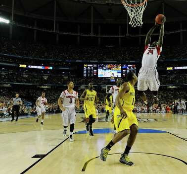 Louisville forward Montrezl Harrell (24) prepares to dunk the ball against Michigan forward Glenn Robinson III (1) during the first half of the NCAA Final Four tournament college basketball championship game Monday, April 8, 2013, in Atlanta. (AP Photo/NCAA Photos, Chris Steppig) Photo: Chris Steppig, Associated Press / NCAA Photos