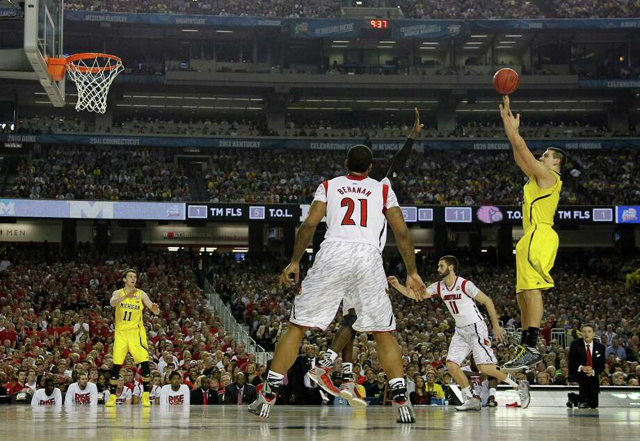 Mitch McGary (4) of the Michigan Wolverines puts up a three-point shot against Louisville during first-half action in the NCAA Tournament final at the Georgia Dome in Atlanta, Georgia, Monday, April 8, 2013. (Mark Cornelison/Lexington Herald-Leader/MCT) Photo: Mark Cornelison, McClatchy-Tribune News Service / Lexington Herald-Leader