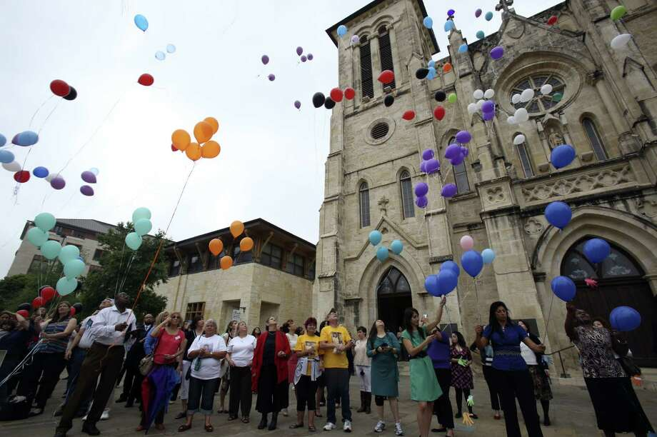 Hundreds of colorful balloons were released during a ceremony iannouncing the start of National Crime Victims' Rights Week. Photo: Helen L. Montoya, San Antonio Express-News
