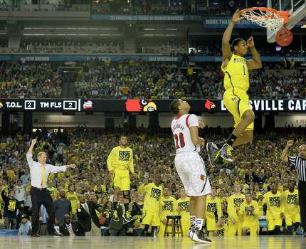 Glenn Robinson III (1) of the Michigan Wolverines puts in a dunk against the Louisville Cardinals in the second half of the NCAA Tournament final at the Georgia Dome in Atlanta, Georgia, Monday, April 8, 2013. (Harry E. Walker/MCT) Photo: Harry E. Walker, McClatchy-Tribune News Service / MCT