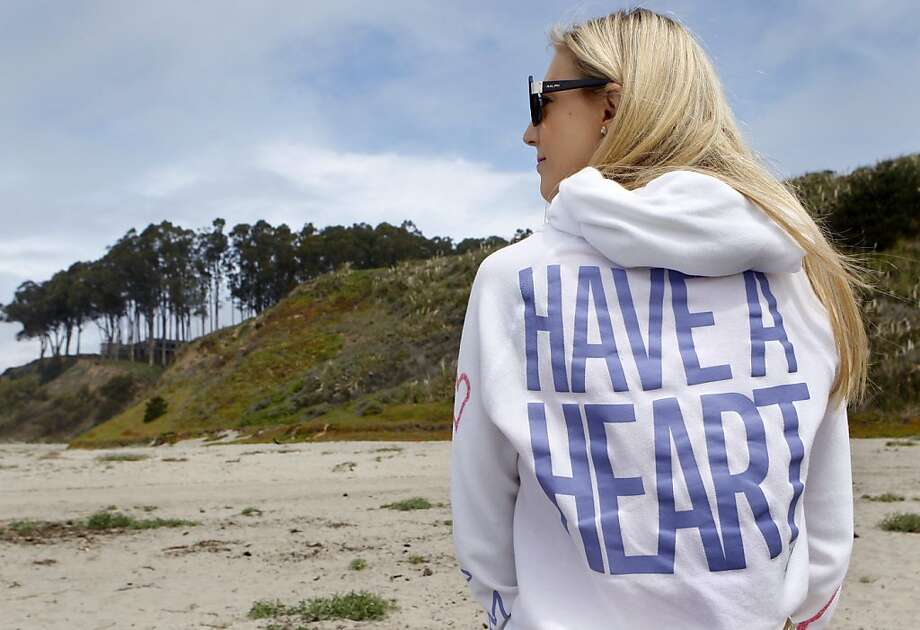 Brooke Stone wears a sweatshirt her parents gave her after her heart surgery last fall. Photo: Paul Chinn, The Chronicle