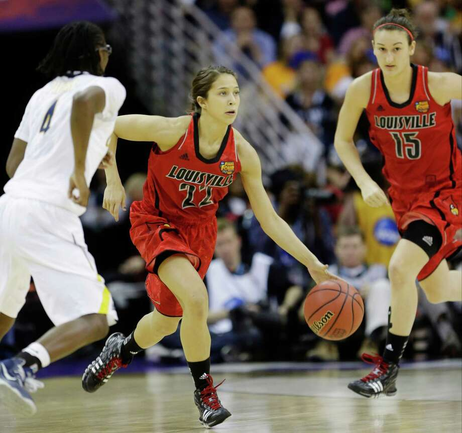 Louisville guard Jude Schimmel (22) dribbles in the first half of a national semifinal against California at the Women's Final Four of the NCAA college basketball tournament, Sunday, April 7, 2013, in New Orleans. (AP Photo/Gerald Herbert) Photo: Gerald Herbert