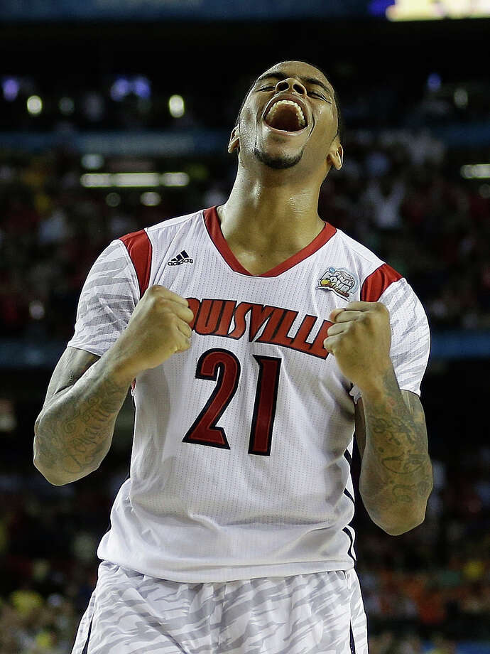 Louisville 82, Michigan 76Road to Atlanta: Look back at the full March Madness bracketLive updates: Follow all the Final Four actionLouisville forward Chane Behanan (21) reacts after defeating Michigan after the second half of the NCAA Final Four tournament college basketball championship game Monday, April 8, 2013, in Atlanta. Louisville won 82-76. (AP Photo/David J. Phillip) Photo: David J. Phillip, Associated Press / AP