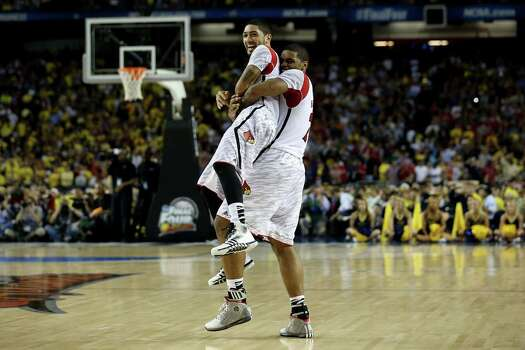 Louisville 82, Michigan 76Road to Atlanta: Look back at the full March Madness bracketLive updates: Follow all the Final Four actionATLANTA, GA - APRIL 08:  (L-R) Peyton Siva #3 and Chane Behanan #21 of the Louisville Cardinals celebrate as they won 82-76 against the Michigan Wolverines  during the 2013 NCAA Men's Final Four Championship at the Georgia Dome on April 8, 2013 in Atlanta, Georgia. Photo: Streeter Lecka, Getty Images / 2013 Getty Images